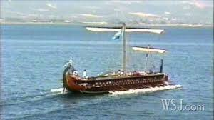 A rooky trireme going into battle with its mast still up